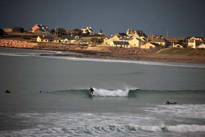 Surfing near Mossies in Brandon Bay